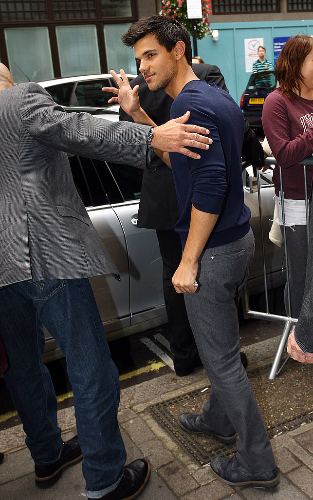 Taylor Lautner made his way out of Radio One in London.