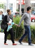 Jessica Alba and Cash Warren hold hands in LA.