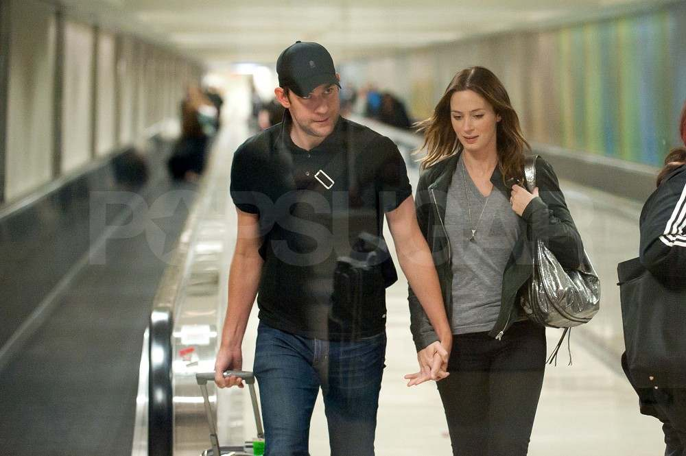 John Krasinski and Emily Blunt walk through LAX.