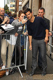 Taylor Lautner took a picture with a female fan.