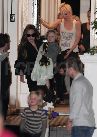 Shiloh Jolie-Pitt, Zahara Jolie-Pitt, Knox Jolie-Pitt, and Angelina Jolie are shown out by Gwen Stefani.