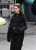 Anne Hathaway's hair was slicked back for her day of work.