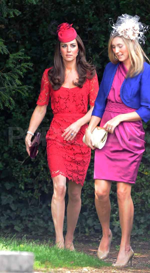 Kate Middleton, Duchess of Cambridge, in a red lace Collette Dinnigan number.