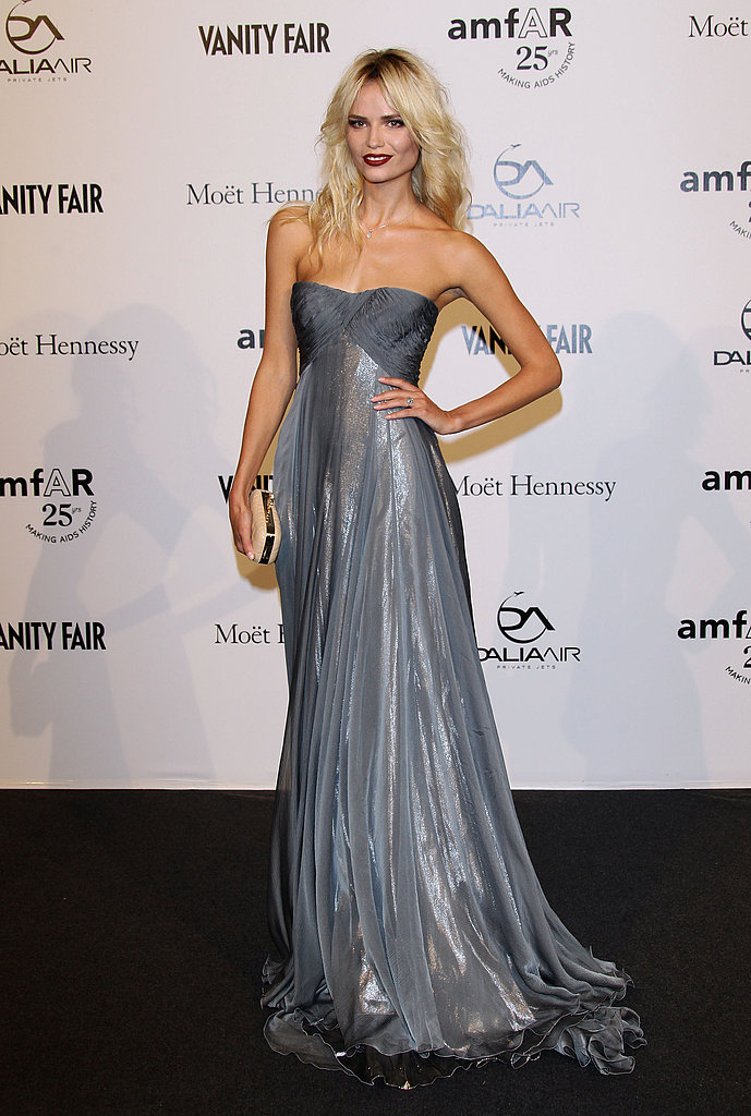 Natasha Poly posed pretty in a metallic Roberto Cavalli gown and sexy red lips at the amfAR gala.
