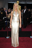 Shimmering in a Calvin Klein gown on 2011 Oscars red carpet.
