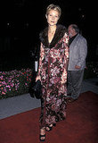 A fur-trimmed  coat and super-short cut at a premiere in 1997.
