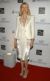 Showing off her sophisticated side in white satin at a charity event in 2009.
