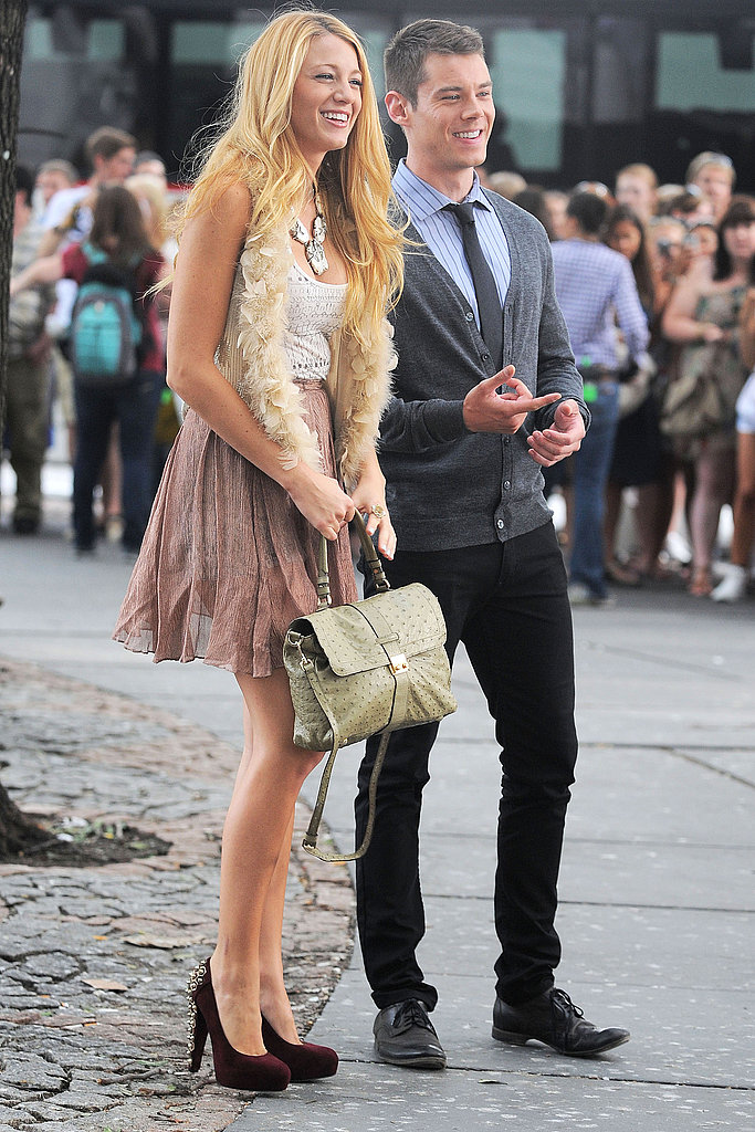 Blake donned a cute feathery vest and pleated skirt while on set — we love her suede pumps.