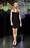 Poppy Delevigne attended Dolce & Gabbana's runway show wearing a sexy black lace by the brand paired with peep-toe pumps.