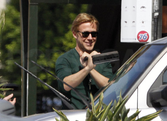 Ryan Gosling washes a car.