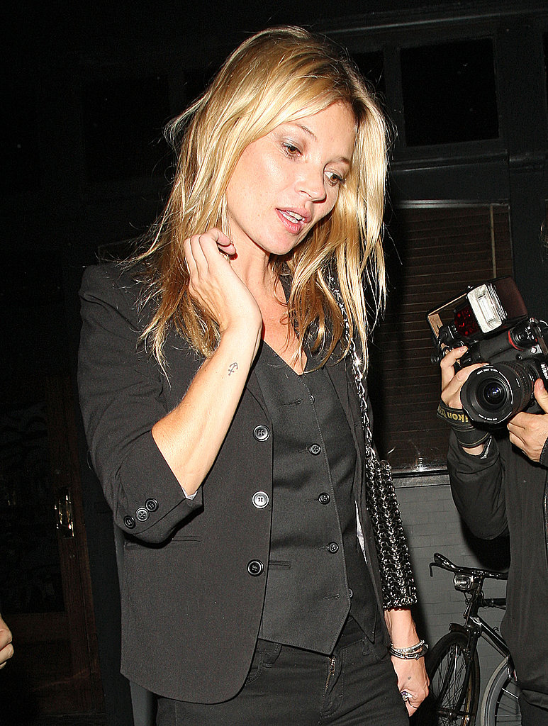 Kate Moss left the Groucho Club in London.