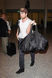 Robert Pattinson carried his bag off to the side in Toronto.