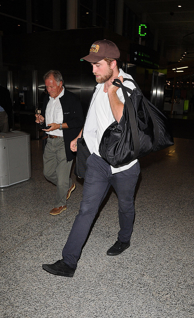 Robert Pattinson walked in black sneakers.