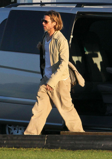 Brad Pitt walking toward the set of his new movie.