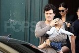 Orlando Bloom and Miranda Kerr leave their Paris hotel with son Flynn Bloom.