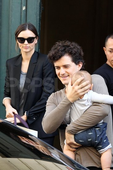 Orlando Bloom leaves his Paris hotel for a fun day with son Flynn and wife Miranda Kerr.