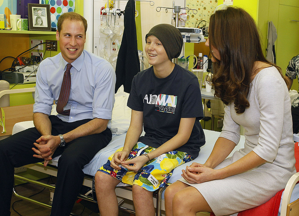 Prince William and Kate Middleton sat with a boy at the Royal Marsden Hospital.