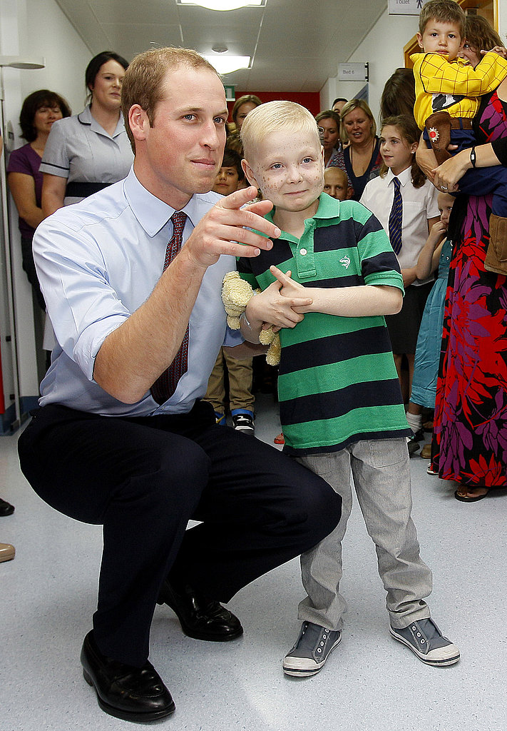 Prince William talked with a little boy at a children's hospital.