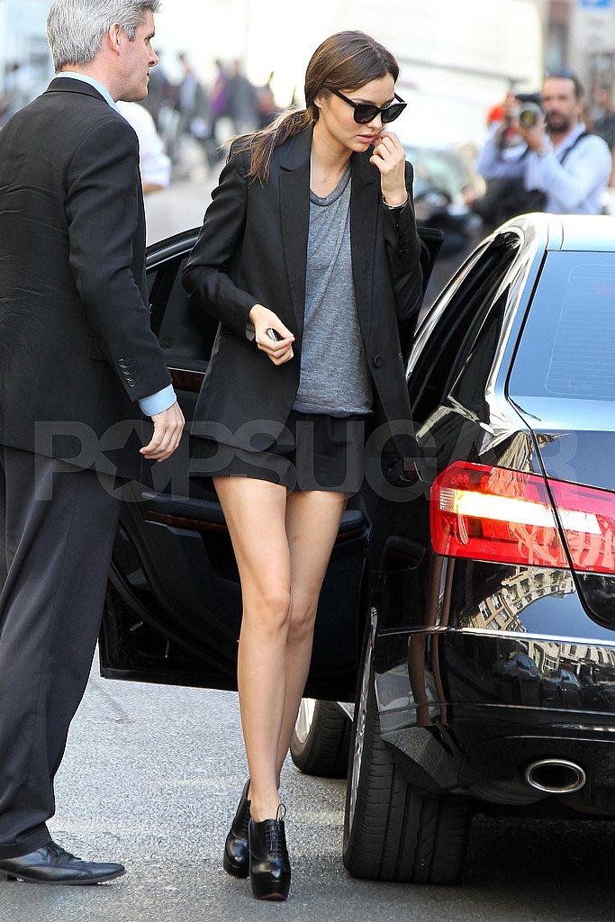 Miranda Kerr wears short shorts and a blazer.