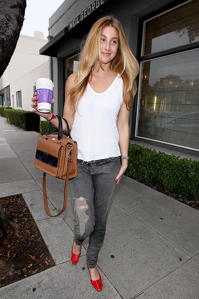 Whitney Port executed eclectic cool with distressed denim, a sweet Kate Spade bag, and a pair of red buckle-adorned flats.   Shop the look: