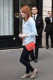 Emma Stone added a pop of red via an enviable Jason Wu crossbody bag.