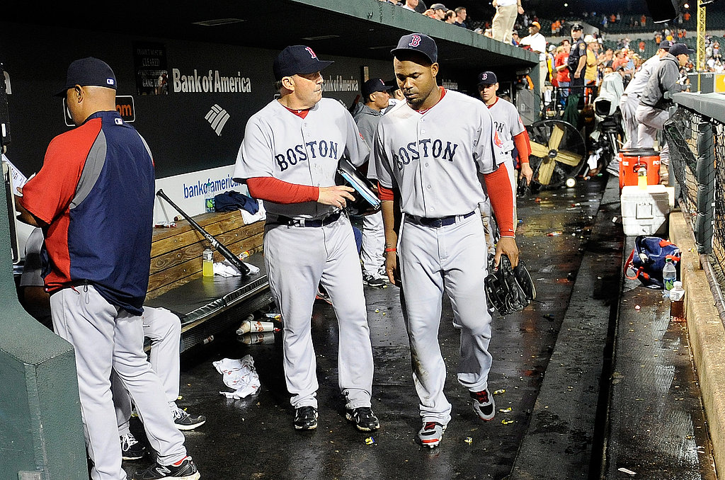 Carl Crawford walks with Red Sox first base coach after last night's loss.
