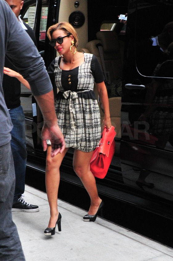 Beyoncé carried a large red bag to an appointment in NYC.