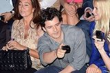 Orlando Bloom takes a photo.
