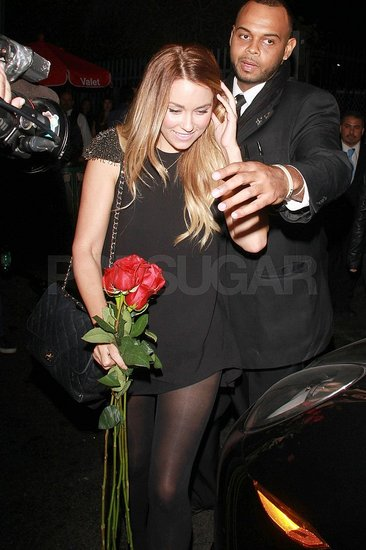 Lauren Conrad carried red roses.