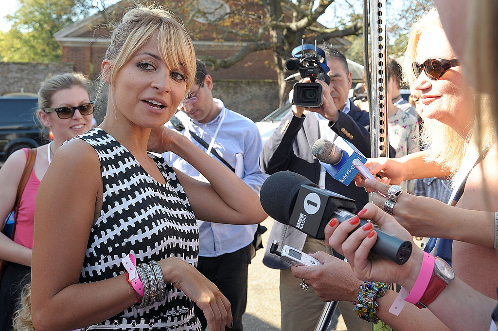 Nicole Richie does interviews at a Disney event.