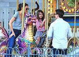 Tom Cruise directed Katie Holmes and Suri Cruise for a photo on a carousel.
