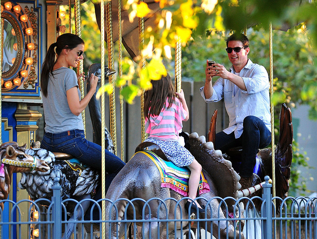 Tom Cruise snapped pics of Katie Holmes and Suri Cruise on a carousel in Pittsburg.