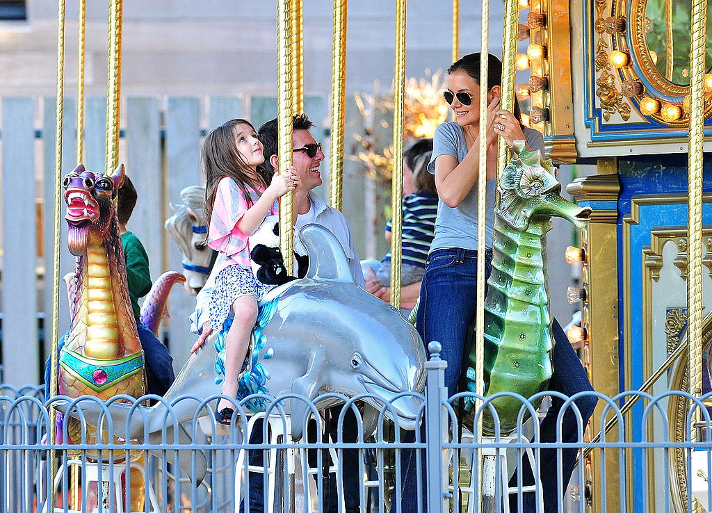 Suri Cruise laughed on a dolphin on the Schenley Plaza carousel in Pittsburg.