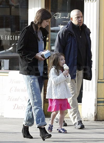 Suri enjoyed her large ice cream cone.