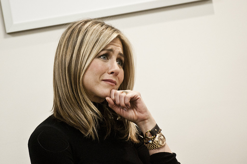 Jennifer Aniston listened intently.