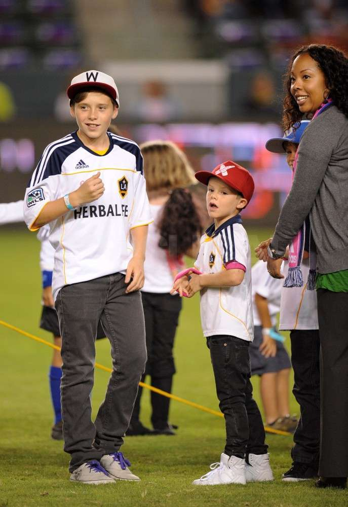Brooklyn Beckham and Cruz Beckham wore matching jerseys.