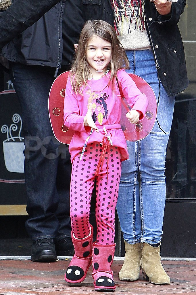 Suri Cruise dressed like a ladybug.