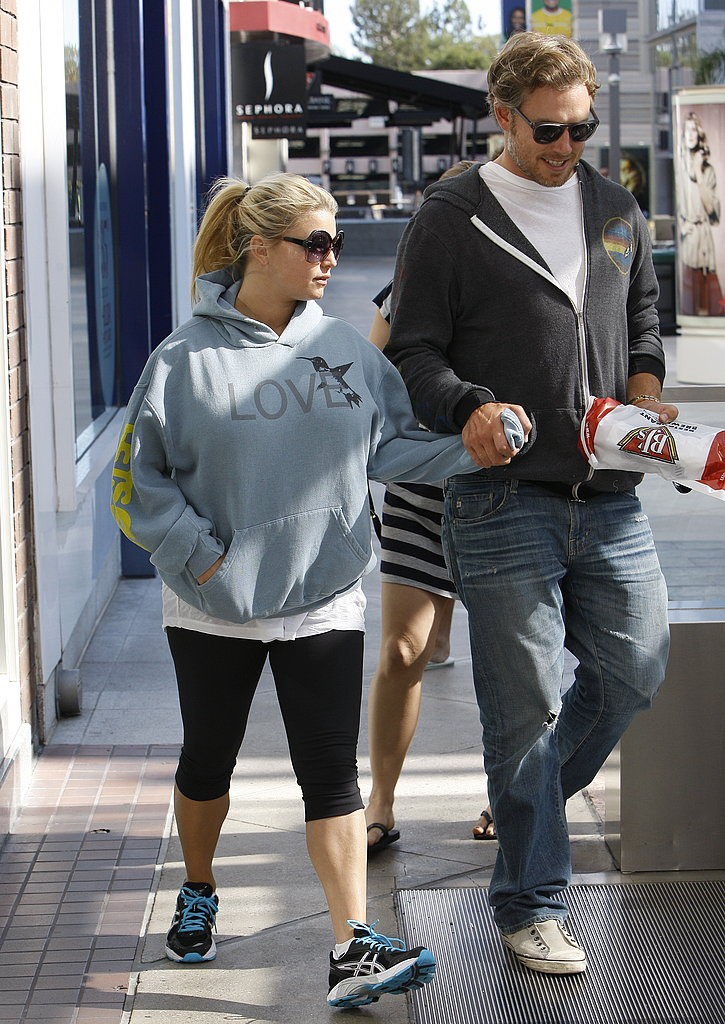 Jessica Simpson and Eric Johnson hold hands.