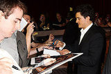 Orlando Bloom signs autographs at the London premiere of The Three Musketeers.