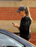 Gisele Bundchen checked her phone leaving the gym in Boston.