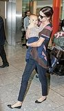 Miranda Kerr Flies Through Heathrow With Baby Flynn in Her Arms