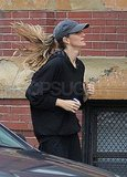 Gisele Bundchen kept her hair covered under a cap.