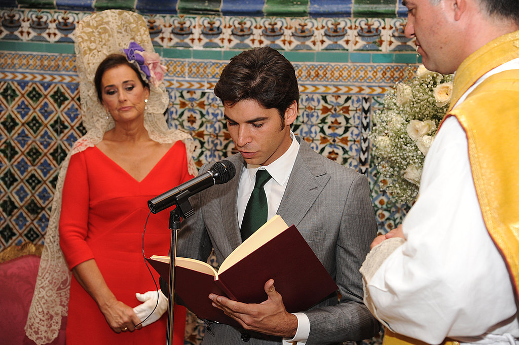 Bullfighter Cayetano Rivera Ordonez speaks while the matron of honor Carmen Tello stands during the ceremony.