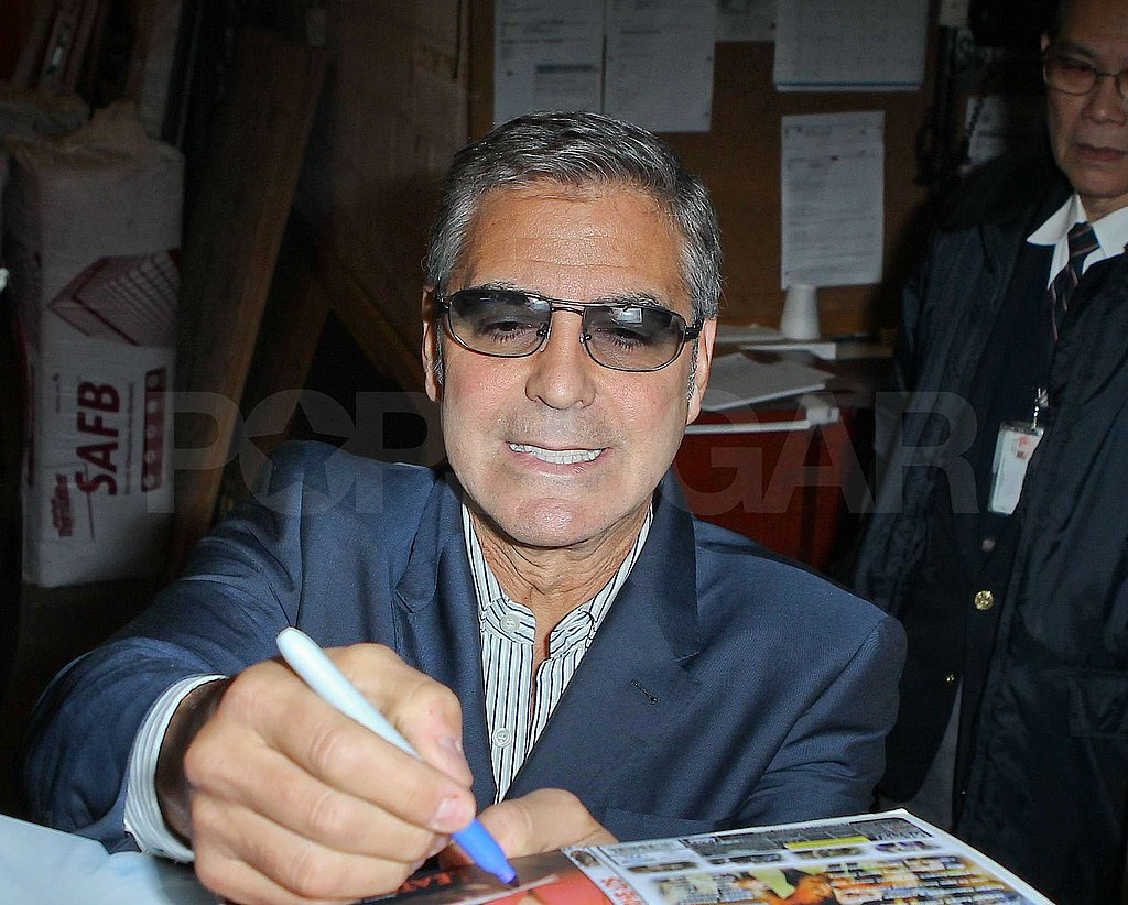 George Clooney sported blue-tinted shades.
