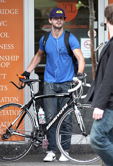 Shia LaBeouf unlocked his bike in Vancouver.