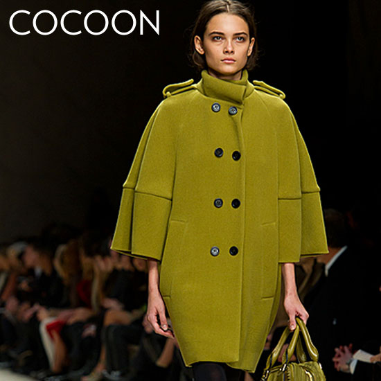 Why we love it: A cocoon coat differentiates itself with a covetable silhouette. We love the chic play on proportion from Fall runways like Burberry. How to wear it: The cocoon coat is a great way to inject a dose of the on-trend into your Fall wardrobe. Because the shape is such a statement, we recommend pairing it with understated separates, like a great pair of skinny pants for perfect office attire.  Shop the runway: Burberry Sculptural Wool Cape Coat ($3,595)