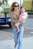 Sarah Jessica Parker rocked a crossbody bag as she carried Marion Broderick.