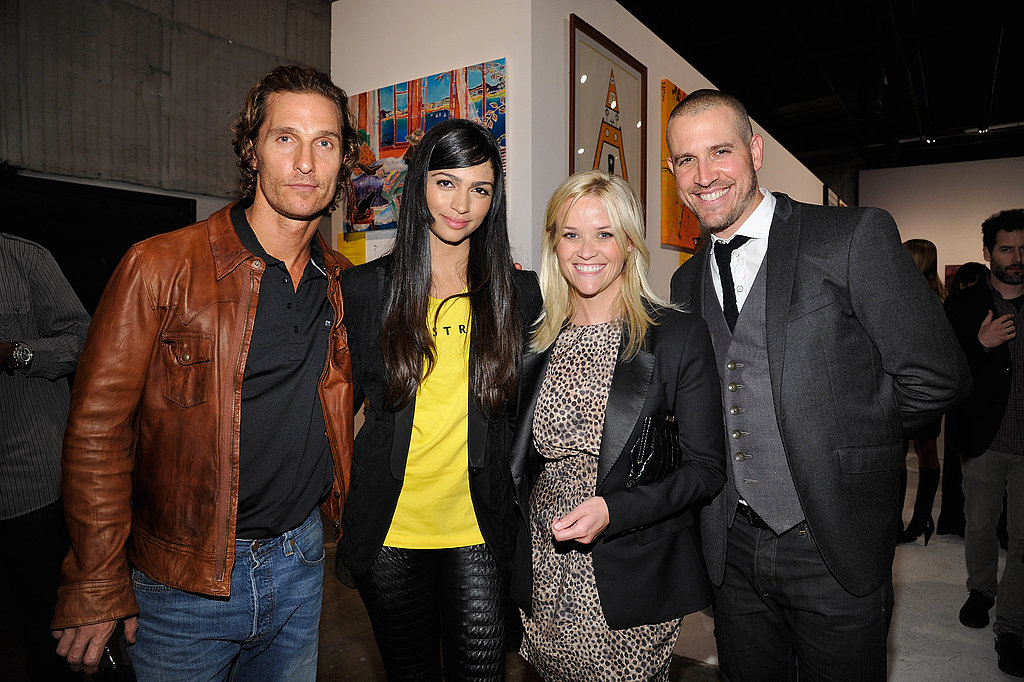 Matthew McConaughey and Camila Alves smile for a photo with Reese Witherspoon and Jim Toth.