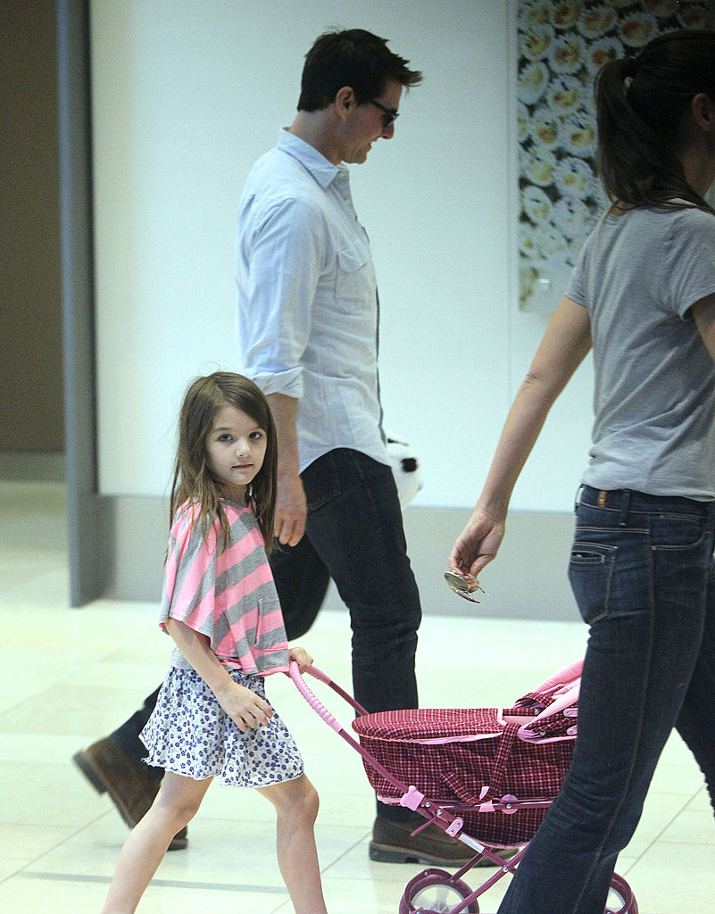Suri Cruise opted for a skirt in Pittsburg with mom, Katie Holmes, and dad, Tom Cruise.