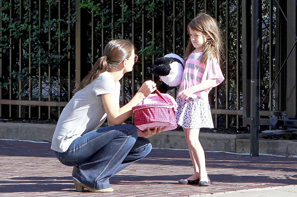 Kate Holmes and Suri Cruise carried a doll around in a carrier.